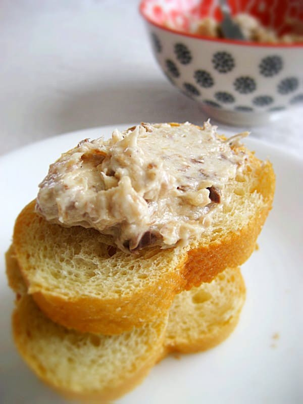 French sardine pate on sliced baguette.