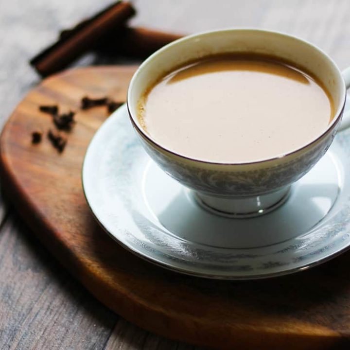 Indian Masala Chai Recipe. An authentic, Indian tea recipe flavored with cardamom, cinnamon, cloves, ginger and sugar. I lOVE making this!! It's a perfect cuppa anytime.   FusionCraftiness.com