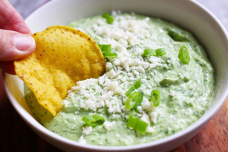 Creamy Jalapeno & Avocado Salsa. A fresh and creamy salsa with some bite. Great for chips, tacos, fish and chicken. Can be used as a veggie dip too! This vegetarian salsa is easy and fast in a food processor.   FusionCraftiness.com