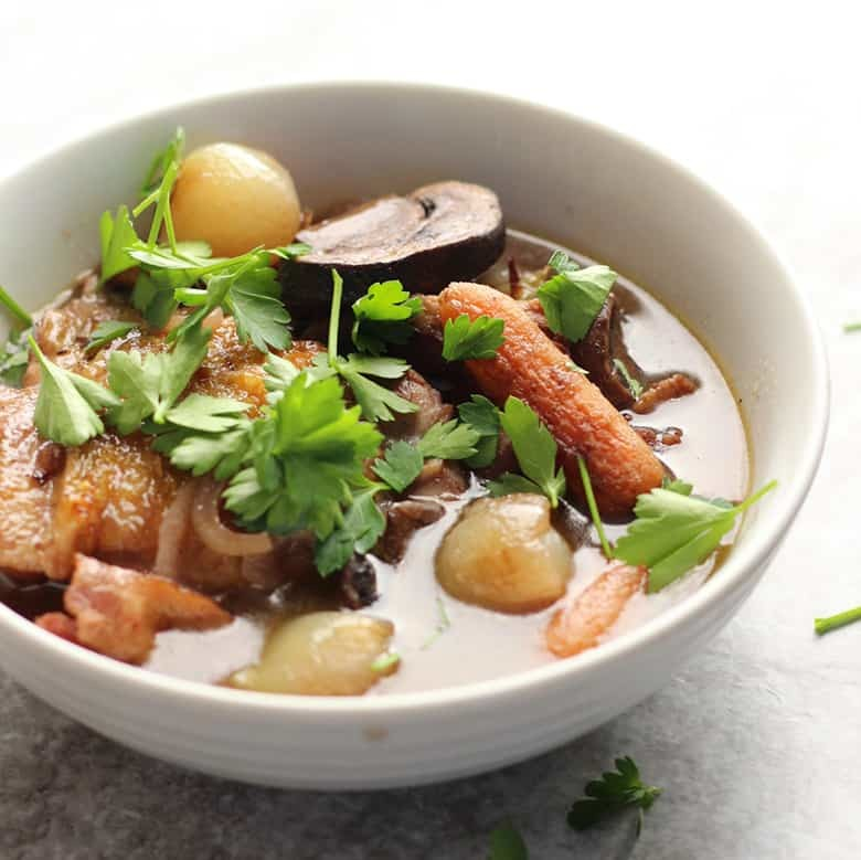 How to make Coq Au Vin, chicken with wine. An easy method similar to Beouf Bourguignon, this recipe layers on flavors and crates very few dirty dishes. A one pot meal!