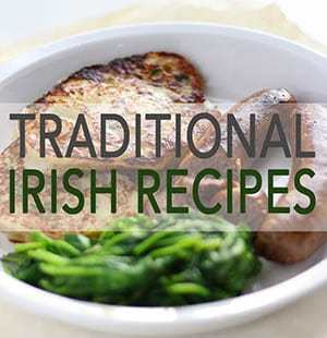 A picture of Irish Boxty, bangers and greens.