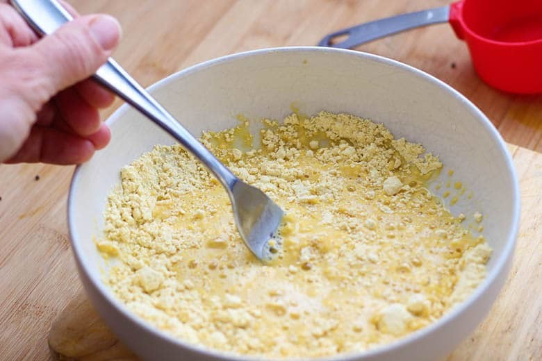 Stirring the batter in a bowl.
