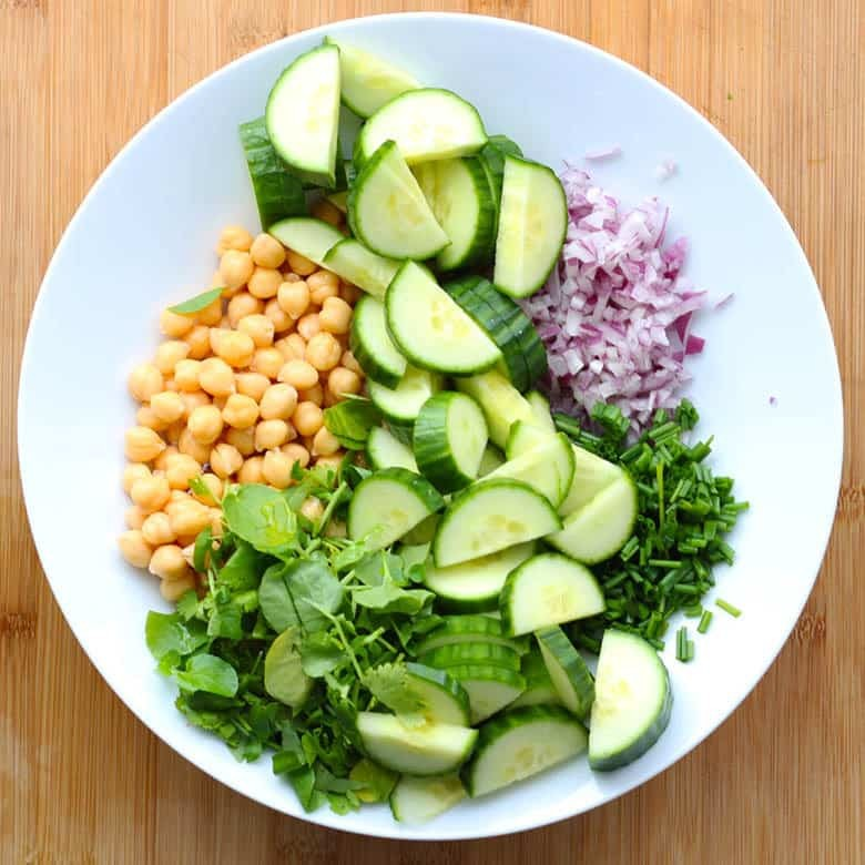 Ingredients for salad in a white bowl.