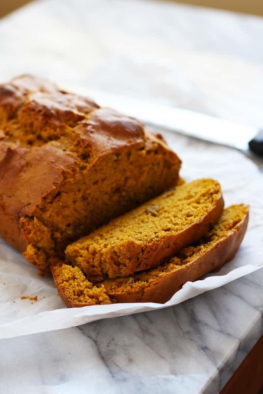 A loaf of pumpkin bread sliced.