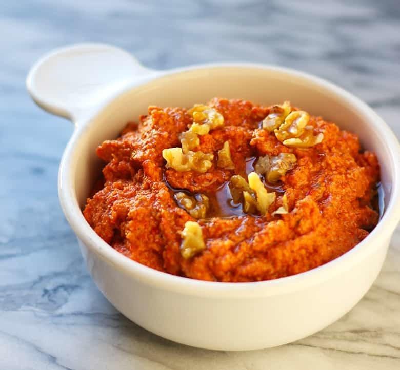 A bowl of Muhammara dip.