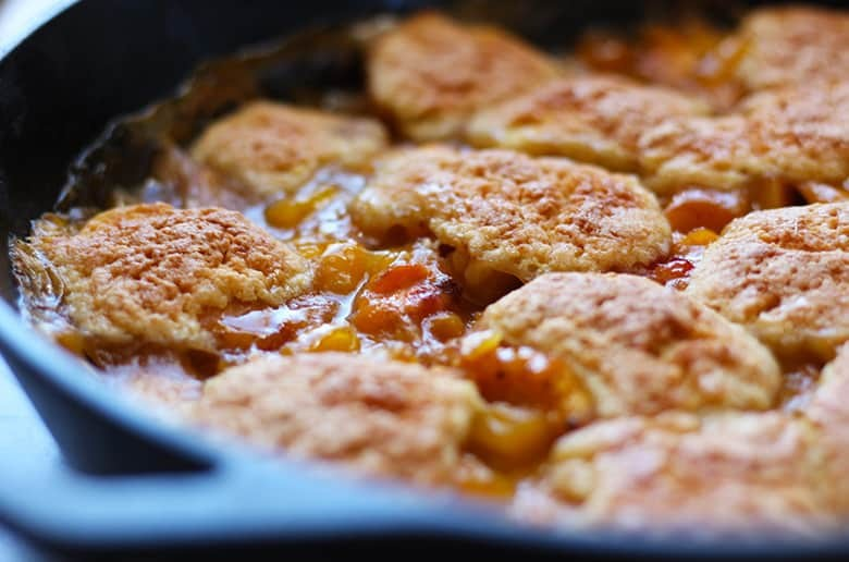 Cast iron skillet with peach cobbler.
