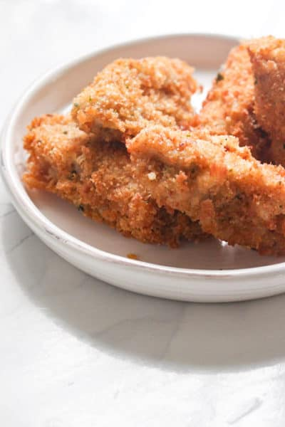 Tuna croquette tapas on a white plate.